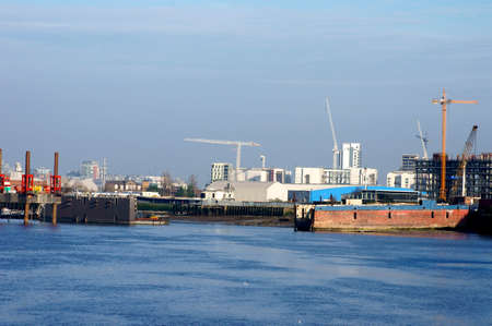 conveyors: The industrial port at the river Thames in London with cranes, conveyors, ships and boats.