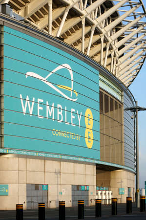 wembley: London, UK - November 28, 2014: A detail of the exterior facade of the new Wembley stadium with a billboard on November 28, 2014 in London. Editorial
