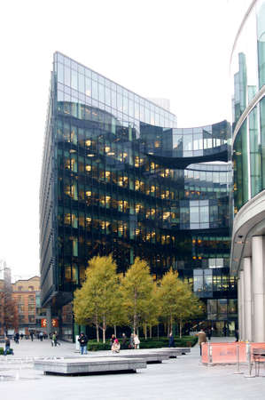 parking facilities: London, UK - November 28, 2014: A modern office building of Ernst & Young on the banks of the River Thames in the borough of Southwark on 28 November 2014 in London. Editorial