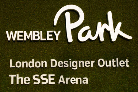 wembley: London, UK - November 28, 2014: The Shield of the Wembley Park with the SSE arena and an outlet center on a non-woven fabric on November 28, 2014 in London. Editorial