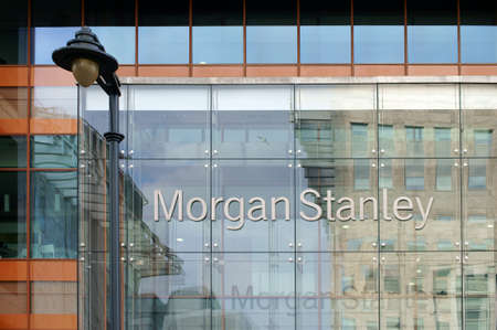 stanley: London, UK - November 29, 2014: The facade of modern bank building from Morgan Stanley with reflections and a nostalgic lantern on November 29, 2014 in London. Editorial