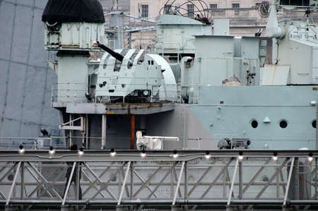 flak: London, UK - November 28, 2014: A woman enters the warship HMS Belfast on the River Thames on 28 November 2014 in London. Editorial