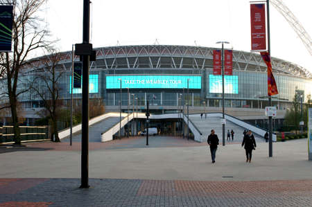 wembley: London, UK - November 28, 2014: Visitors and tourists climb up the stairs to the main entrance of the new Wembley Stadium on November 28, 2014 in London. Editorial