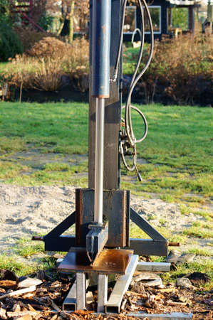 splitter: The front view of a stationary hydraulic wood splitter.