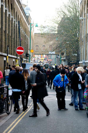 east end: London, UK - November 29, 2014: The by tourists and locals well-known busy and visited Brick Lane in the East End on November 29, 2014 in London. Editorial