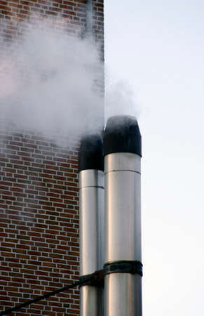 chimney corner: The photograph of a smoky chimney made of stainless steel.