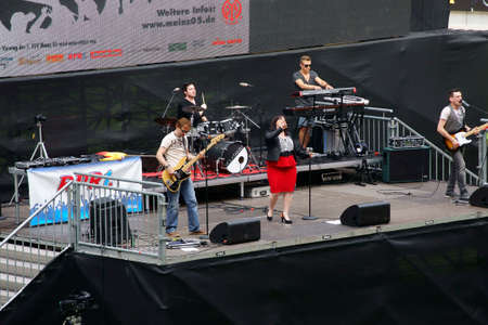 Mainz, Germany - June 26, 2014: A Band is playing a Live Show at the public viewing of the Soccer World Cup 2014 in the Co Face Arena Mainz on June 26, 2014 in Mainz.