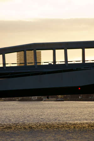 inland waterways: A modern road bridge after the sunrise in the harbor of Amsterdam. Stock Photo