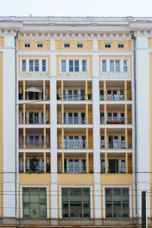listed buildings: The facade of an old, newly renovated building with nostalgic balconies