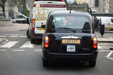 westminster city: London, UK - November 27, 2014: The rear view of a taxi in the City of Westminster, Which holds on a pedestrian crossing on November 27, 2014 in London. Editorial