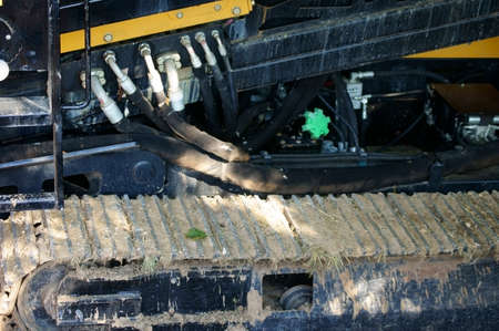 tracked: The close-up of the chain and hydraulic excavator from a tracked vehicle or a
