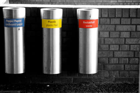 waste material: Three Adjacent pendant stainless steel waste containers for various waste material.