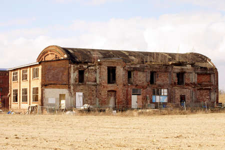 disused: An old brick ruin on the disused industrial site of an old factory. Stock Photo
