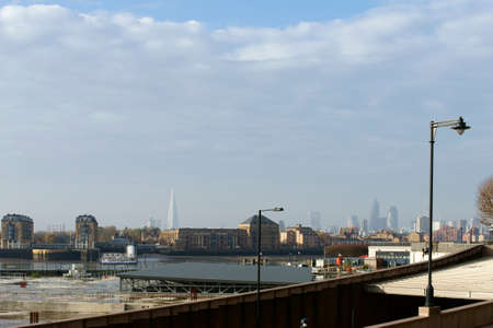 southwark: London, UK - November 28, 2014: A construction site in the financial center on the banks of the River Thames in Canary Wharf in front of the skyline and skyscrapers of Southwark on November 28, 2014 in London.