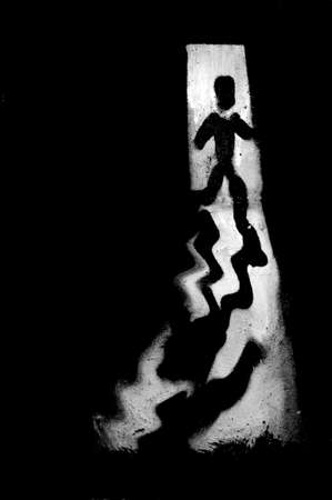 flee: The illustration of a silhouette running from a person, Which runs from the dark through a door into the light.