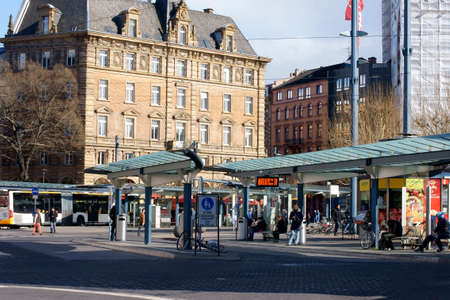 MAINZ: Mainz, Germany - March 31, 2015: The central bus station in Mainz in front of the main station with pedestrians and people on March 31, 2015 in Mainz.