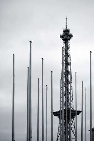 flagpoles: Berlin, Germany - April 8, 2015: The steel construction of the Berlin Radio Tower stands behind a row of flagpoles on April 08, 2015 in Berlin. Editorial