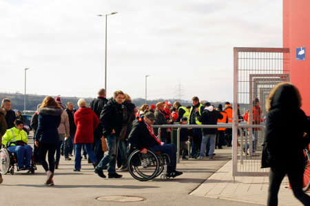wheelchair users: Mainz, Germany - March 22, 2015: The separate entrance for wheelchair users and fans of the soccer club FSV Mainz 05 by a ticket inspection on March 22, 2015 in Mainz.