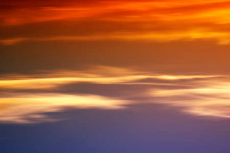 cloud formations: The blurred and abstract clouds and colors of a sunset.