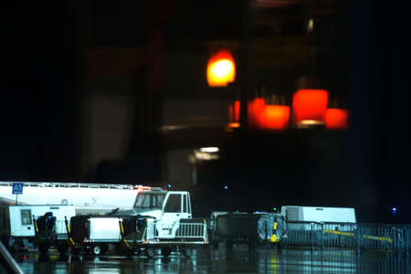 loading dock: Tanker trucks and vans are at night on an aircraft loading dock.