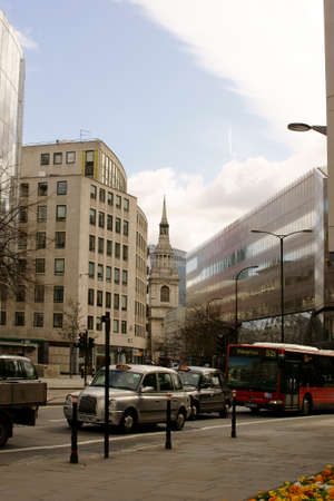 churchyard: London UK 31 March 2015: Road traffic with taxis and buses on the St. Paul39s Churchyard on 31 March 2015 in London.