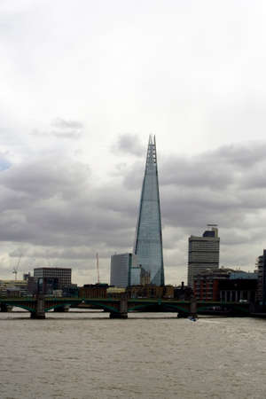 southwark: London UK 31 March 2015: The modern skyscraper The Shard behind the Southwark Bridge and the River Thames on March 31 2015 in London.