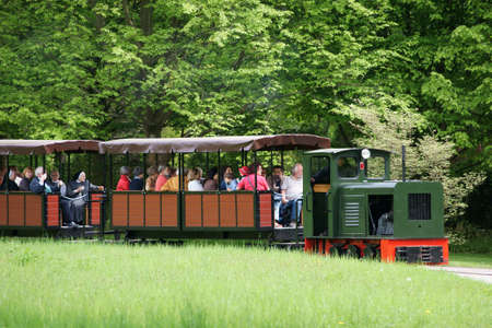 narrow gauge railroads: Berlin Germany 06 May 2015: The park railway and train of the Britz Garden in Berlin39s Neukoelln diatrict with visitors and tourists on May 06 2015 in Berlin.