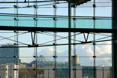 db: Berlin Germany April 02 2015: The glass front of the main station in Berlin with a view of a DB skyscraper on April 02 2015 in Berlin.