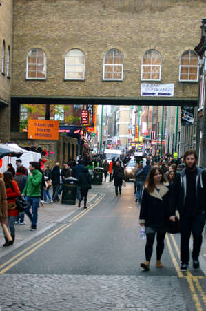 east end: London UK November 29 2014: Tourists and locals By wellknown busy and visited street market at the Brick Lane in the East End on November 29 2014 in London.
