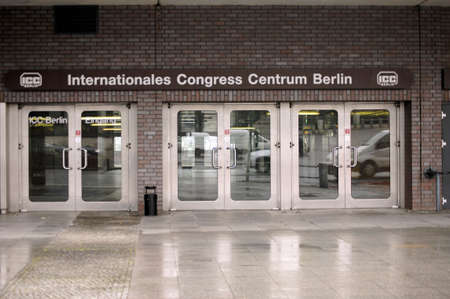 congress center: Berlin, Germany - March 01, 2015: The shiny metallic entrance doors to the International Congress Center in Berlin with traffic reflections in the windows on March 01, 2015 in Berlin.