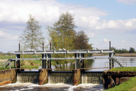 barrage: An open river sluice or barrage with waterfall-like flow. Stock Photo