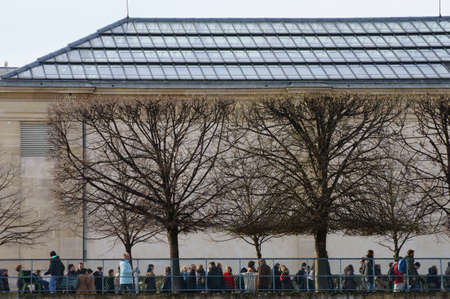 muse: Paris, France - December 29, 2013: A queue of people waiting in front of the Art Museum Muse dOrsay in Paris outside under a glass roof for entrance on December 29, 2013 in Paris.