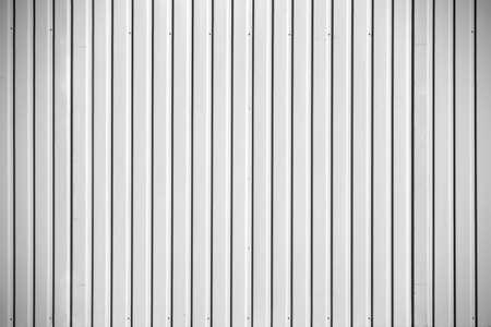 metal wall: The closeup of the corrugated metal wall of a Portakabin.