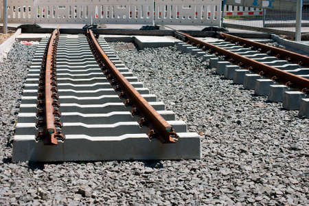underlay: The construction of a railway line for a tram with rails, gravel and underlay sleepers. Stock Photo