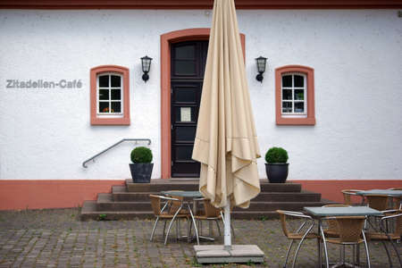 MAINZ: Mainz, Germany - July 17, 2015: The entrance of the Citadel cafe with outdoor seating and a parasol on July 17, 2015 in Mainz. Editorial