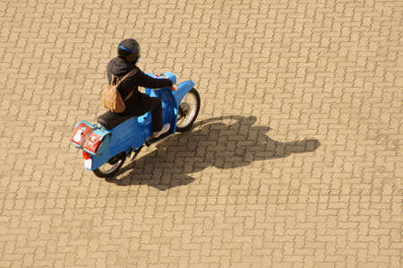 The aerial view of an old nostalgic small motor cycle, moped. Banco de Imagens