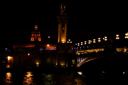 alexandre: Paris, France - December 31, 2013: The illuminated Pont Alexandre III Bridge at night with the lighted Invalides in the background on December 31, 2013 in Paris.