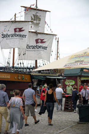 MAINZ: Mainz, Germany - July 11, 2015: Pedestrians and visitors of the Summer Party Mainzer Bierbrse passing the stall of the Stoertebeker Brewing specialty brewery on July 11, 2015 in Mainz. Editorial