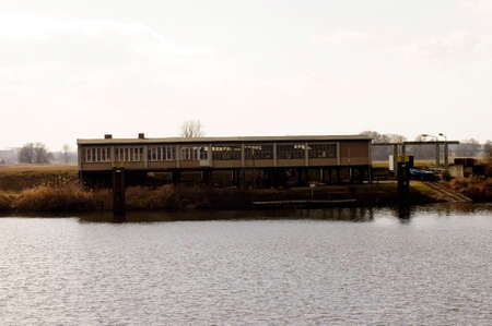 boathouse: A boathouse or boat shed stands on the dike of the river Elbe.