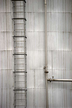 welds: The outer body of a liquid reservoir of metal with a ladder and pipes.