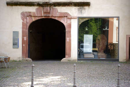 artefacts: Mainz, Germany - July 17, 2015: The Gate southwestern gate system of the Citadel in Mainz with a billboard and historical artefacts behind a showcase on July 17, 2015 in Mainz.