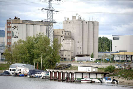 industrial wasteland: Mainz, Germany - August 14, 2015: The historic and old factory site of H-malt factory beside the River Rhine with silos and storage buildings on August 14, 2015 in Mainz. Editorial