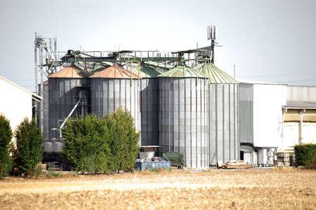 grain storage: A grain silo with several storage tanks of a farm.