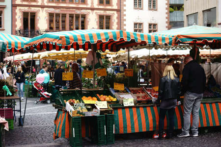 weekly market: Mainz, Germany - September 4, 2015: The stalls of the weekly market in the town square in Mainz with various fruits and vegetables from regional suppliers on September 4, 2015 in Mainz.