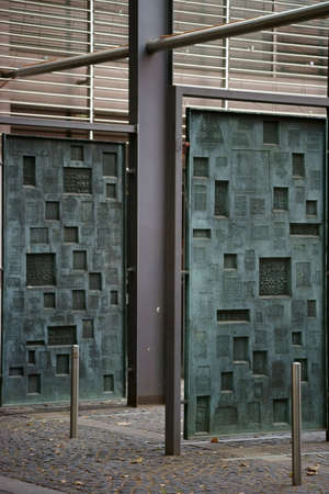 gutenberg: Mainz, Germany - September 4, 2015: Hanging Printing Plates made of copper with different motives and characters in the courtyard of the Gutenberg Museum on September 4, 2015 in Mainz. Editorial