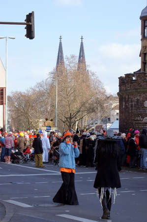 colorfully: Cologne, Germany - Mar 02, 2014: A Straenzug the Klner Carnival with colorfully dressed people and the Klner Dom in the background on 02. Mar 2014th Editorial