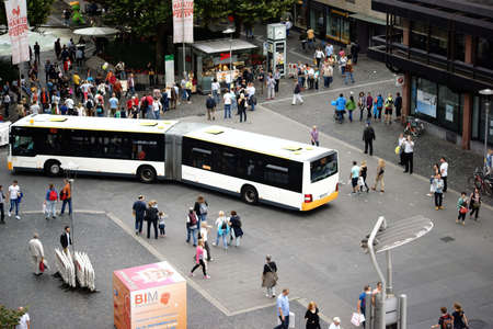 gutenberg: Mainz, Germany - September 11, 2015: Bus routes and groups of people on the Gutenberg square corner Schoeffer Street on September 11, 2015 in Mainz. Editorial