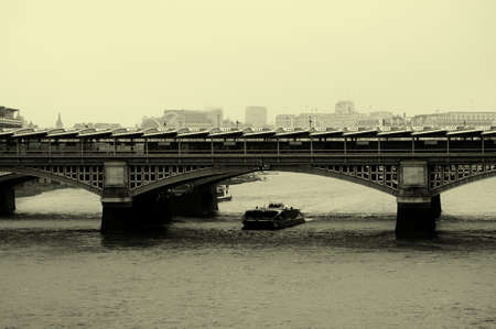 blackfriars bridge: The Blackfriars bridge over the River Thames in London with solar panels on the roof.