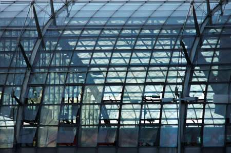 roof framework: A circular domed roof made of glass on one side of the Berlin central station. Stock Photo