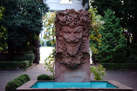 bacchus: Mainz, Germany - September 19, 2015: A fountain with a sculpture of Bacchus in the courtyard of the Kupferberg terraces on September 19, 2015 in Mainz.